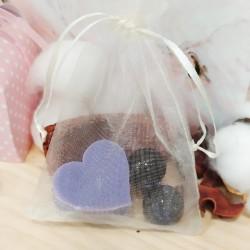 Detalle sencillo para tus invitados, bolsa de organza con perlitas de baño.